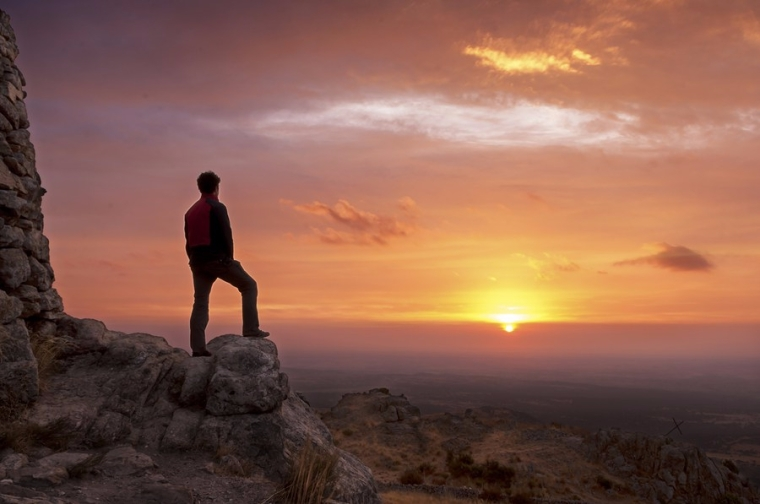 bigstock-man-on-top-of-a-mountain-stand-51437401.jpg